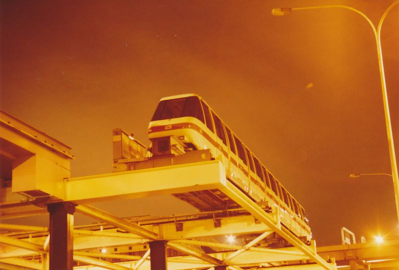 A night time shot from Darling Drive looking up at a Monorail parked for the night.